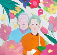 花と鳥に囲まれた熟年夫婦