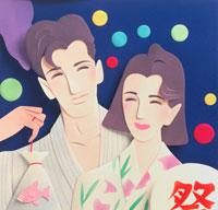 うちわと金魚を持つ浴衣姿のカップル