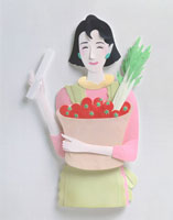 トマトとセロリを持ちエプロンを着た女性
