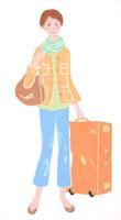 大きなトランクを持つ旅行中の女性