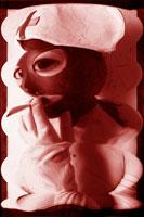 看護婦の制服と目抜きマスクをした女性 セピア
