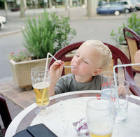 France. The family summer holiday.Felix drinks Dad's beer. in Foix, the Ariege district of France.
