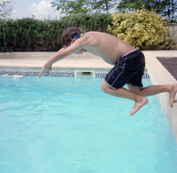 France. The family summer holiday. Hotel pool near Royan in France. Max learning to dive.