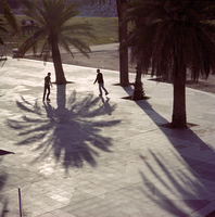 SPAIN. Barcelona. Commercial shoot for Barclays Bank. Gay couple rollerblading. 2002.