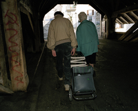 SWITZERLAND. Olten. Couple with shopping trolley. 2003