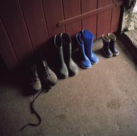 GB. Devon. Lettaford. 'Sanders'. Landmark Trust House. Easter. The family's collection of boots and wellingtons. 2005.