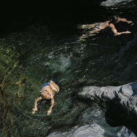 FRANCE. Corsica. Family summer holiday near Calvi. Felix NAYLOR MARLOW swiming in a river. 2005.