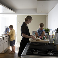 GB. England. London. getting breakfast ready with Fiona, Theo and Felix.   2007.