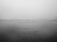 Cuxhaven, Lower Saxony, Germany. April 2013.  A person walks through the mudflats of Cuxhaven.  (Photo by 02265047670| 写真素材・ストックフォト・画像・イラスト素材|アマナイメージズ
