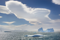 Lenticular clouds and icebergs, Antarctic Sound, Antarctica