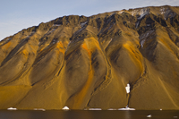 Fjord walls colored by iron deposits, Scoresby Sound, East G