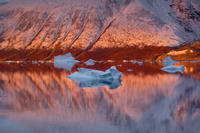 Snow covered slope at sunrise, East Greenland