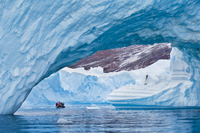 Tourists among icebergs, Scoresby Sound, East Greenland