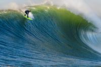Surfer riding wave, Mavericks, Monterey Bay, California