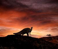 夕暮れの荒野を歩くシャントゥンゴサウルス