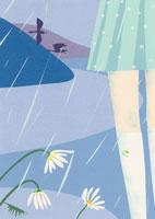 雨降りに立つ女性の足元