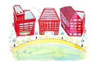赤い建物と大きな池のある街