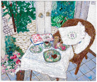 カフェテーブルに置いたお茶と本