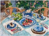 藍の染付のテーブルマットとお皿と料理