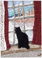 窓の外の雪を見る黒猫