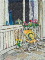 窓辺の椅子に置いた帽子とお花