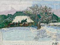 雪の積もった民家と木