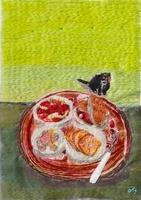 プレートにのった食べ物と猫