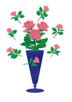 青いガラスの花瓶とバラ