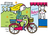 自転車で急ぐ女性