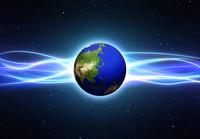 宇宙に浮かぶ地球と光線