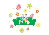 ソファーに座って寛ぐ家族