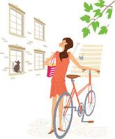自転車で買い物をする女性とネコ