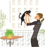 黒ネコを抱き上げる女性