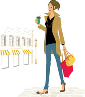 飲み物を持って歩く女性