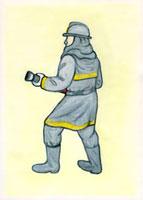 消火するポーズの消防員