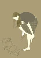 サンダルを試着している女性
