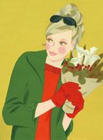 小さい花束を持った女性