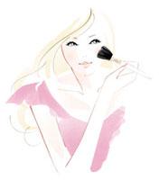 チークを塗っている女性