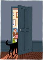 扉のところに立っている犬と奥にいるご主人