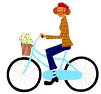 自転車のカゴに花を入れて乗っている女性