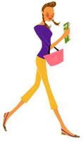 雑誌を持って歩いている女性