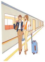 電車のホームを歩く二人の女性