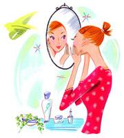 鏡の前で肌の手入れをしている女性