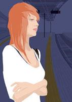 駅で電車を待つ女性