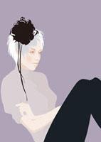 髪飾りをつけた座っている女性