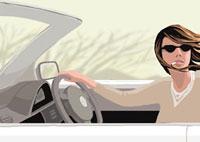 タバコを吸いながら運転する女性
