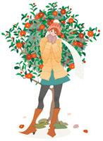 木の前に立つ冬服の女性
