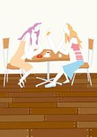 リビングでお茶をしながら会話する女性二人