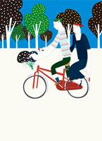 自転車に二人乗りするカップル