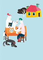 庭で食事をする夫婦と犬